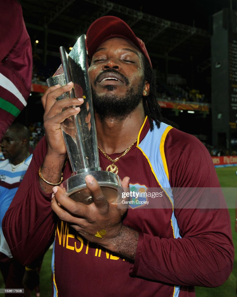 <a gi-track='captionPersonalityLinkClicked' href=/galleries/search?phrase=Chris+Gayle+-+Cricket+Player&family=editorial&specificpeople=206191 ng-click='$event.stopPropagation()'>Chris Gayle</a> of the West Indies celebrates with the trophy after winning the ICC World Twenty20 2012 Final between Sri Lanka and the West Indies at R. Premadasa Stadium on October 7, 2012 in Colombo, Sri Lanka.