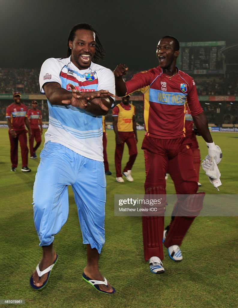 <a gi-track='captionPersonalityLinkClicked' href=/galleries/search?phrase=Chris+Gayle+-+Cricket+Player&family=editorial&specificpeople=206191 ng-click='$event.stopPropagation()'>Chris Gayle</a> of the West Indies congratulates <a gi-track='captionPersonalityLinkClicked' href=/galleries/search?phrase=Darren+Sammy&family=editorial&specificpeople=2920912 ng-click='$event.stopPropagation()'>Darren Sammy</a> on hitting the winning runs to defeat Australia during the ICC World Twenty20 Bangladesh 2014 match between the West indies and Australia at Sher-e-Bangla Mirpur Stadium on March 28, 2014 in Dhaka, Bangladesh.