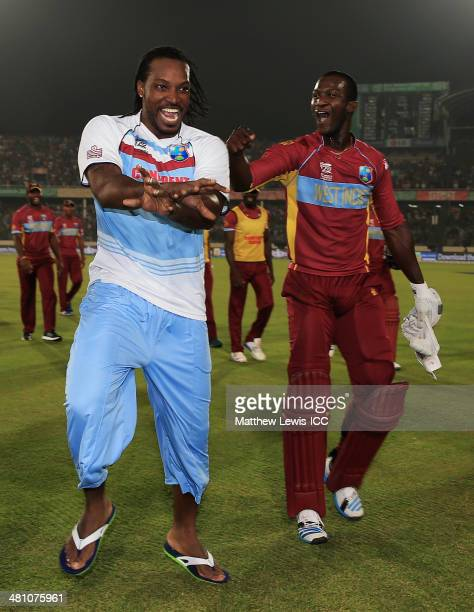 Chris Gayle of the West Indies congratulates Darren Sammy on hitting the winning runs to defeat Australia during the ICC World Twenty20 Bangladesh...