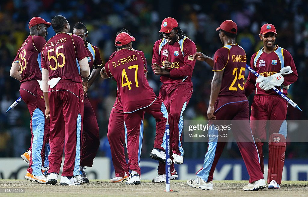 <a gi-track='captionPersonalityLinkClicked' href=/galleries/search?phrase=Chris+Gayle+-+Cricket+Player&family=editorial&specificpeople=206191 ng-click='$event.stopPropagation()'>Chris Gayle</a> of the West Indies dances with his team mates, after defeating Australia during the ICC World Twenty20 2012 Semi Final match between Australia and West Indies at R. Premadasa Stadium on October 5, 2012 in Colombo, Sri Lanka.