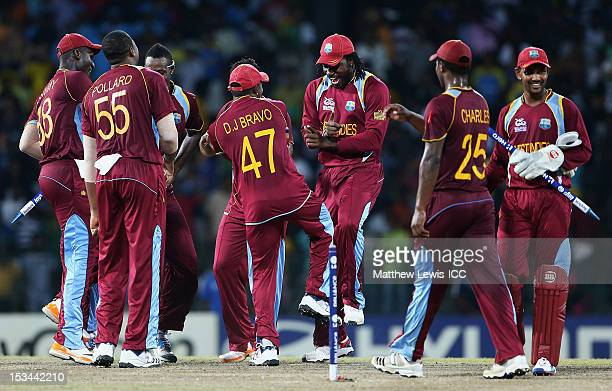Chris Gayle of the West Indies dances with his team mates after defeating Australia during the ICC World Twenty20 2012 Semi Final match between...
