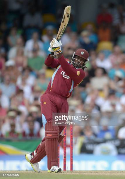 Chris Gayle of the West Indies hits out for six runs during the 1st T20 International between the West Indies and England at Kensington Oval on March...