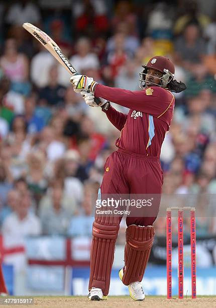 Chris Gayle of the West Indies hits out for six runs during the 2nd T20 International match between the West Indies and England at Kensington Oval on...