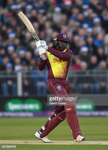 Chris Gayle of the West Indies hits out for six runs during the NatWest T20 International match between England and the West Indies at Emirates...
