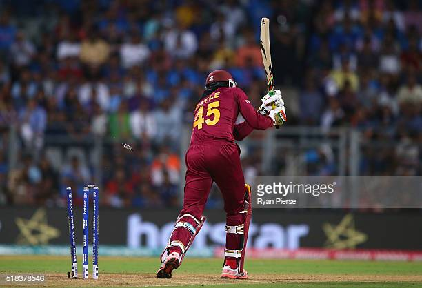 Chris Gayle of the West Indies is bowled by Jasprit Bumrah of India during the ICC World Twenty20 India 2016 Semi Final match between West Indies and...