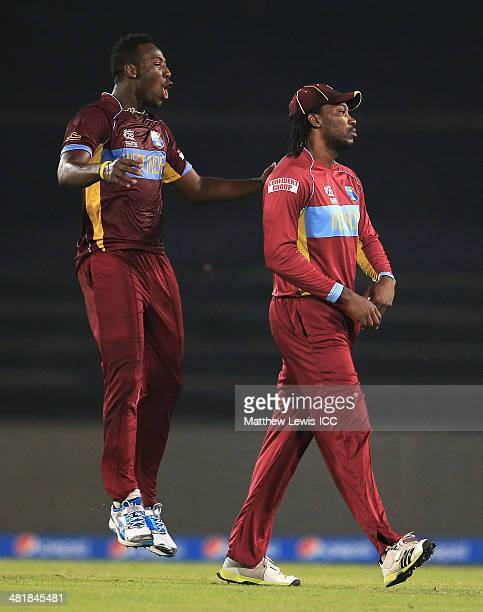 Chris Gayle of the West Indies is congratulated by Andre Russell on catching Mohammad Hafeez of Pakistan during the ICC World Twenty20 Bangladesh...