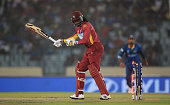 Chris Gayle of the West Indies looks on after being bowled by Lasith Malinga of Sri Lanka during the ICC World Twenty20 Bangladesh 2014 Semi Final...