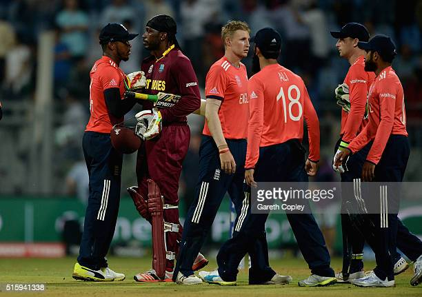 Chris Gayle of the West Indies shakes hands with England players after winning the ICC World Twenty20 India 2016 Super 10s Group 1 match between West...