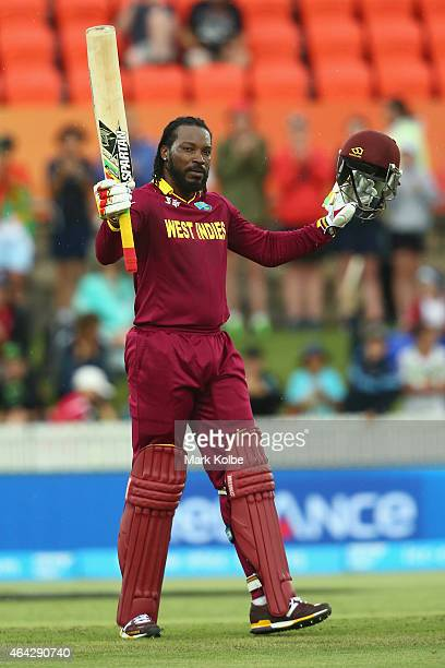 Chris Gayle of West Indies celebrates his century during the 2015 ICC Cricket World Cup match between the West Indies and Zimbabwe at Manuka Oval on...