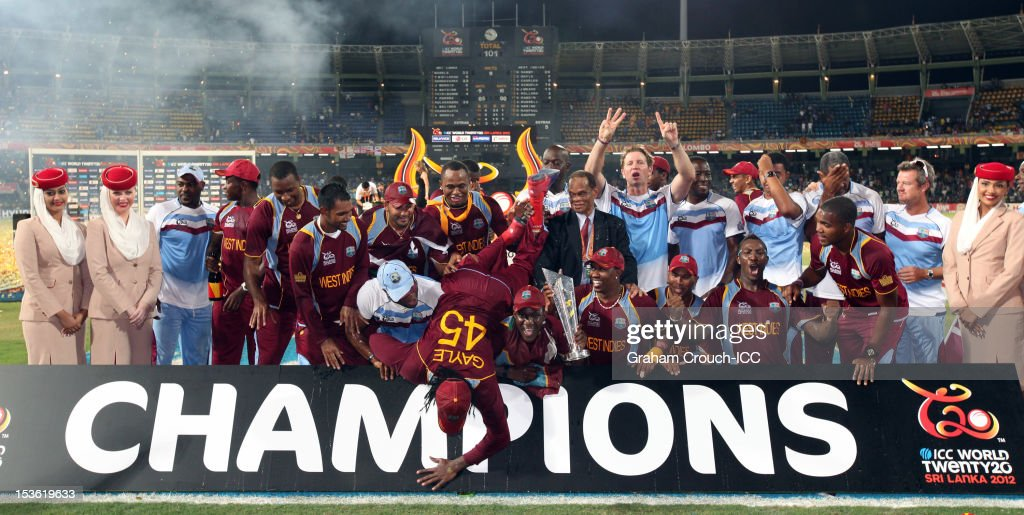 <a gi-track='captionPersonalityLinkClicked' href=/galleries/search?phrase=Chris+Gayle+-+Cricket+Player&family=editorial&specificpeople=206191 ng-click='$event.stopPropagation()'>Chris Gayle</a> of West Indies falls over the champions sign in celebration after defeating Sri Lanka in the ICC World Twenty20 2012 Final between Sri Lanka and West Indies at R. Premadasa Stadium on October 7, 2012 in Colombo, Sri Lanka.