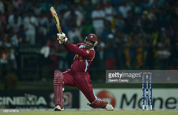 Chris Gayle of West Indies hits out for six during the superover of the ICC World Twenty20 2012 Super Eights Group 1 match between the West Indies...