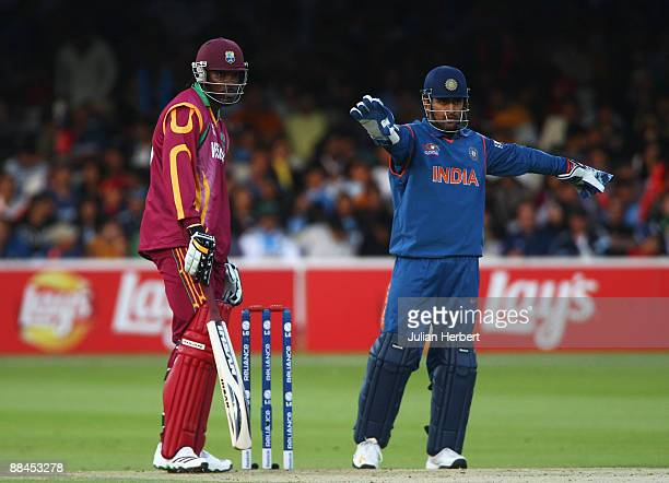 Chris Gayle of West Indies looks on as Mahendra Singh Dhoni of India moves his field during the ICC World Twenty20 Super Eights match between India...