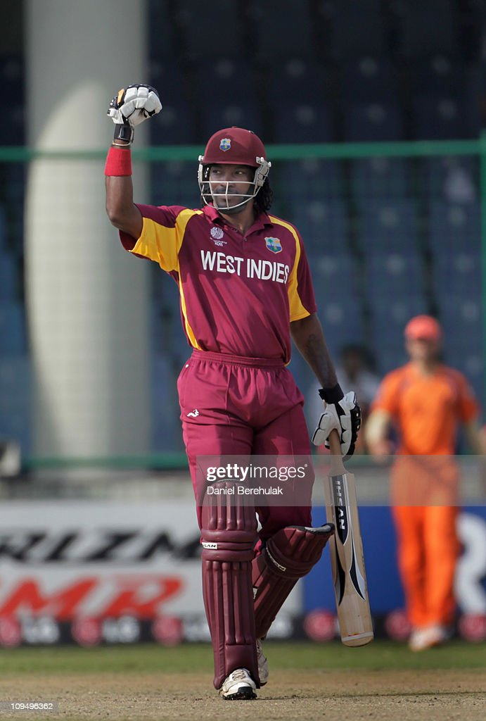 Chris Gayle of West Indies raises his bat on scoring his half century during the 2011 ICC World Cup group B match between Netherlands and West Indies...