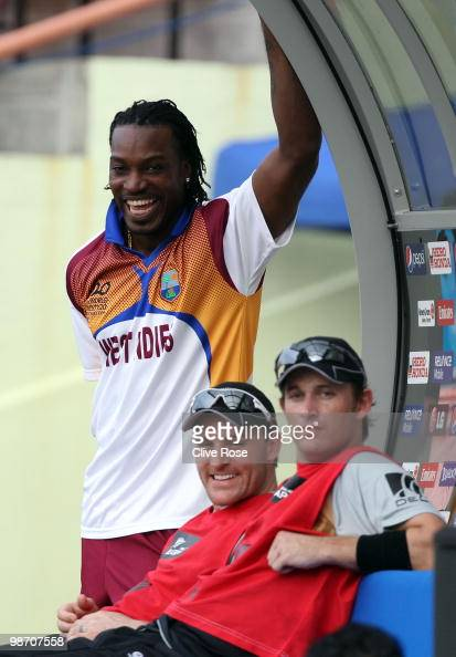 Chris Gayle of West Indies shares a joke with Brendon McCullum and Shane Bond of New Zealand during The ICC T20 World Cup warm up match between...