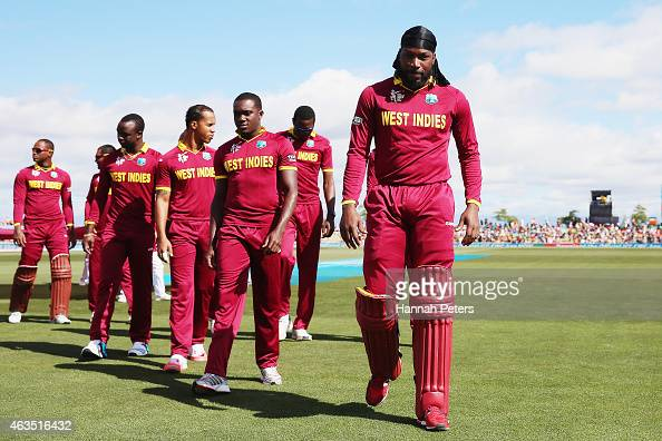 Chris Gayle of West Indies walks off to prepare to bat during the 2015 ICC Cricket World Cup match between the West Indies and Ireland at Saxton...
