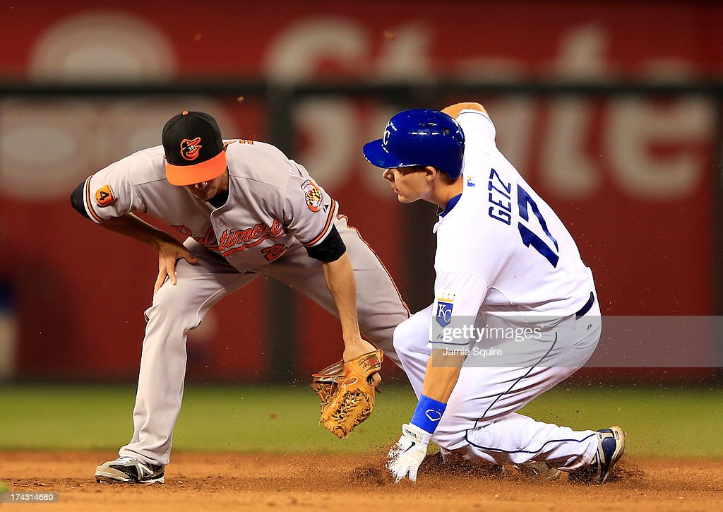 Chris Getz #17 of the Kansas City Royals slides safely into second base for a steal as Brian Roberts #1 of the Baltimore Orioles applies the tag during the game at Kauffman Stadium on July 23, 2013 in Kansas City, Missouri.