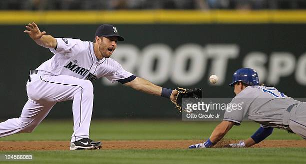 Chris Getz of the Kansas City Royals steals second base against Dustin Ackley of the Seattle Mariners at Safeco Field on September 10 2011 in Seattle...