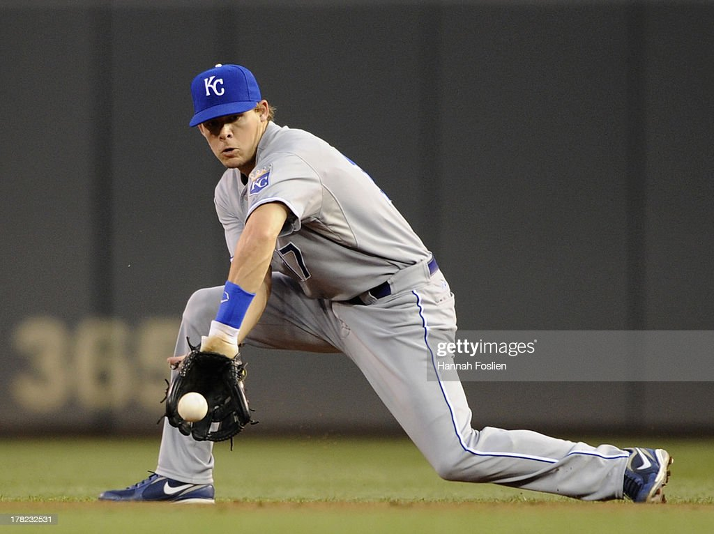 <a gi-track='captionPersonalityLinkClicked' href=/galleries/search?phrase=Chris+Getz&family=editorial&specificpeople=4936717 ng-click='$event.stopPropagation()'>Chris Getz</a> #17 of the Kansas City Royals stops the ball hit by Pedro Florimon #25 of the Minnesota Twins during the third inning of the game on August 27, 2013 at Target Field in Minneapolis, Minnesota.