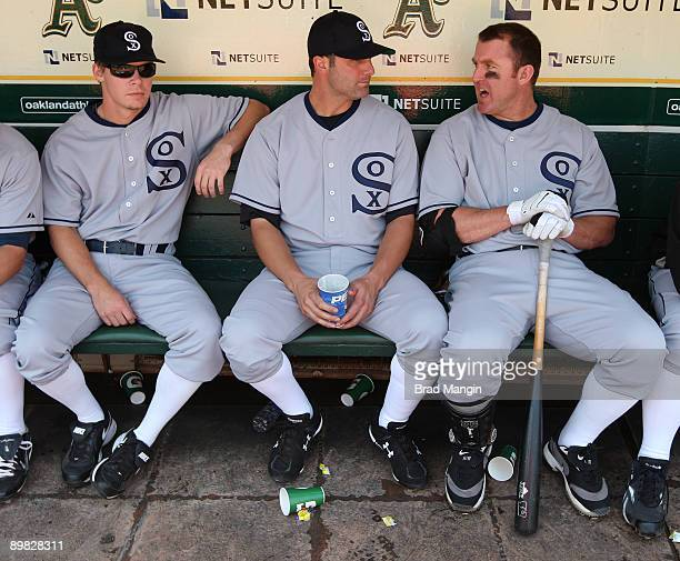 Chris Getz Paul Konerko and Jim Thome of the Chicago White Sox get ready in the dugout before the game against the Oakland Athletics during the...