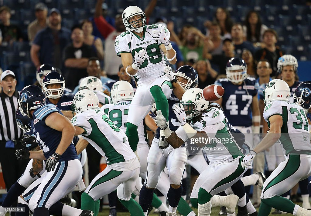 Chris Getzlaf #89 of the Saskatchewan Roughriders cannot come up with an onside kick during CFL game action by the Toronto Argonauts on July 11, 2013 at Rogers Centre in Toronto, Ontario, Canada.