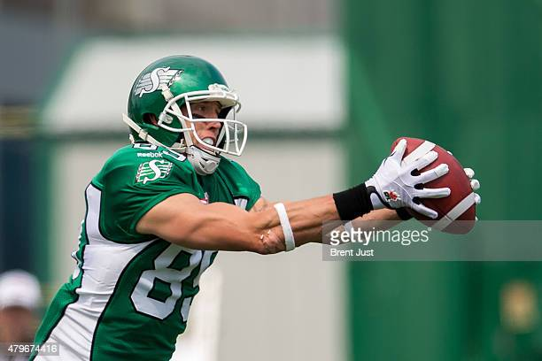 Chris Getzlaf of the Saskatchewan Roughriders hauls in a pass in the end zone which was called back on a penalty in the game between the Toronto...