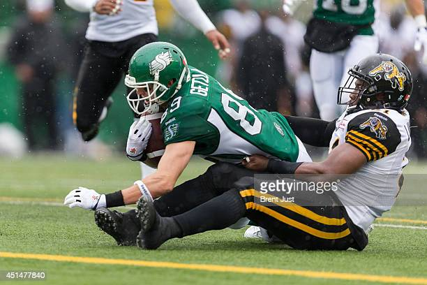 Chris Getzlaf of the Saskatchewan Roughriders reaches for the goal after making a catch during week 1 of the 2014 CFL season at Mosaic Stadium on...