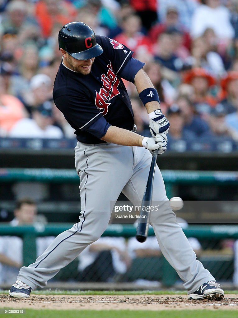 <a gi-track='captionPersonalityLinkClicked' href=/galleries/search?phrase=Chris+Gimenez&family=editorial&specificpeople=4959066 ng-click='$event.stopPropagation()'>Chris Gimenez</a> #38 of the Cleveland Indians singles against the Detroit Tigers to drive in Lonnie Chisenhall during the fourth inning at Comerica Park on June 24, 2016 in Detroit, Michigan.
