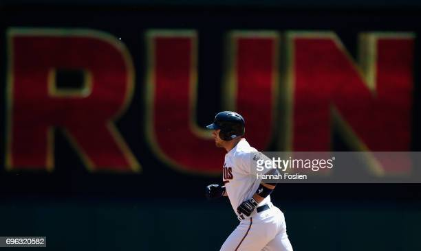 Chris Gimenez of the Minnesota Twins rounds the bases after hitting a threerun home run against the Seattle Mariners during the first inning of the...
