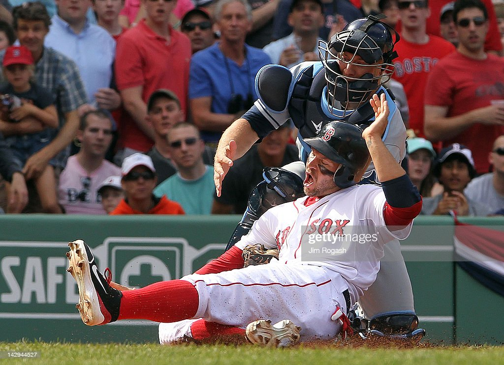 <a gi-track='captionPersonalityLinkClicked' href=/galleries/search?phrase=Chris+Gimenez&family=editorial&specificpeople=4959066 ng-click='$event.stopPropagation()'>Chris Gimenez</a> of the Tampa Bay Rays tags out <a gi-track='captionPersonalityLinkClicked' href=/galleries/search?phrase=Cody+Ross&family=editorial&specificpeople=545810 ng-click='$event.stopPropagation()'>Cody Ross</a> of the Boston Red Sox at the plate in the fifth inning at Fenway Park April 15, 2012 in Boston, Massachusetts. Both teams wore the number 42 in honor of Jackie Robinson Day.