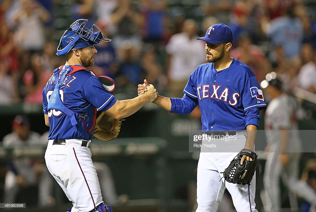 <a gi-track='captionPersonalityLinkClicked' href=/galleries/search?phrase=Chris+Gimenez&family=editorial&specificpeople=4959066 ng-click='$event.stopPropagation()'>Chris Gimenez</a> #60 of the Texas Rangers is congratulates <a gi-track='captionPersonalityLinkClicked' href=/galleries/search?phrase=Joakim+Soria&family=editorial&specificpeople=4175255 ng-click='$event.stopPropagation()'>Joakim Soria</a> #28 for closing out the ninth inning for the win against the Minnesota Twins at Globe Life Park in Arlington on June 27, 2014 in Arlington, Texas.