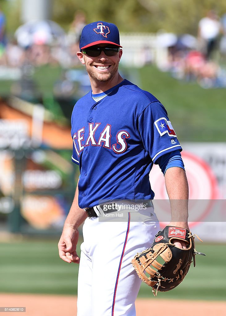 <a gi-track='captionPersonalityLinkClicked' href=/galleries/search?phrase=Chris+Gimenez&family=editorial&specificpeople=4959066 ng-click='$event.stopPropagation()'>Chris Gimenez</a> #38 of the Texas Rangers smiles at some fans during a game against the Los Angeles Dodgers during a spring training game at Surprise Stadium on March 4, 2016 in Surprise, Arizona.