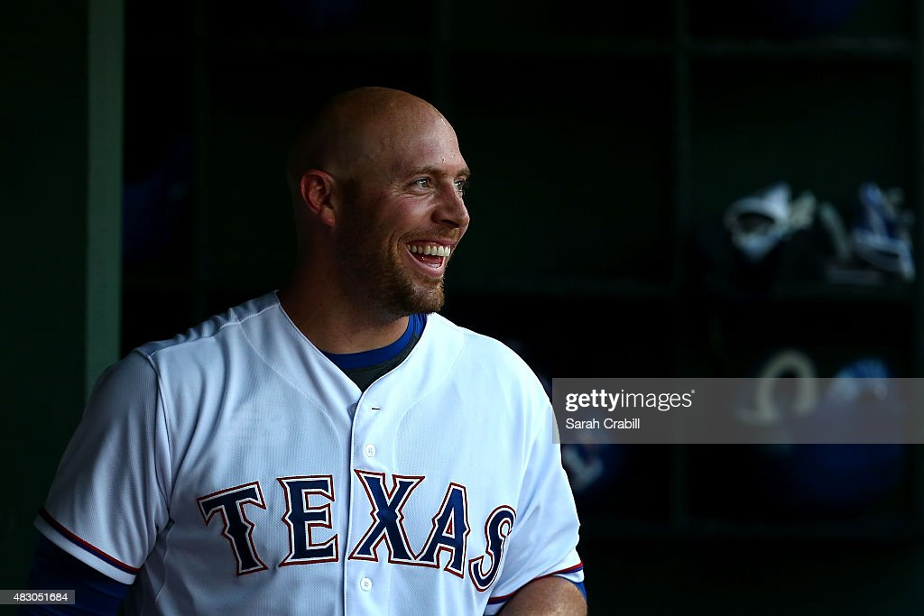 <a gi-track='captionPersonalityLinkClicked' href=/galleries/search?phrase=Chris+Gimenez&family=editorial&specificpeople=4959066 ng-click='$event.stopPropagation()'>Chris Gimenez</a> #38 of the Texas Rangers smiles in the dugout after hitting a home run in the second inning during a game against the Houston Astros at Globe Life Park in Arlington on August 5, 2015 in Arlington, Texas.