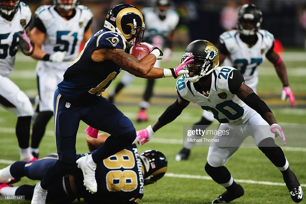 <a gi-track='captionPersonalityLinkClicked' href=/galleries/search?phrase=Chris+Givens&family=editorial&specificpeople=4489301 ng-click='$event.stopPropagation()'>Chris Givens</a> #13 of the St. Louis Rams avoids the tackle of Mike Harris #20 of the Jacksonville Jaguars at the Edward Jones Dome on October 6, 2013 in St. Louis, Missouri.
