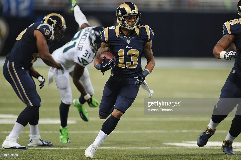<a gi-track='captionPersonalityLinkClicked' href=/galleries/search?phrase=Chris+Givens&family=editorial&specificpeople=4489301 ng-click='$event.stopPropagation()'>Chris Givens</a> #13 of the St. Louis Rams runs with the ball against the Seattle Seahawks in the third quarter at the Edward Jones Dome on October 28, 2013 in St. Louis, Missouri.