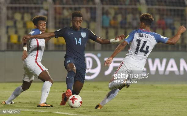 Chris Gloster and Akil Watts of USA tackles Callum HudsonOdoi of England during the quarterfinal football match between USA and England in the FIFA...