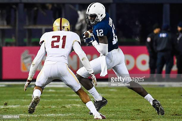 Chris Godwin of the Penn State Nittany Lions attempts to run past Manuel Asprilla of the Boston College Eagles in the fourth quarter of the 2014 New...