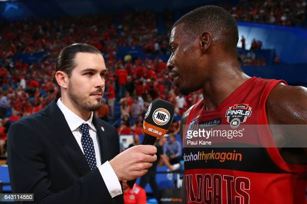 Chris Goulding interviews Casey Prather of the Wildcats at the half time break during the game two NBL Semi Final match between the Perth Wildcats...