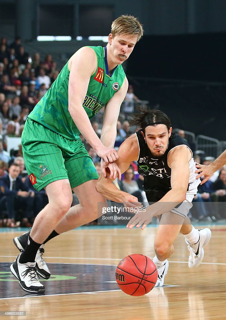 Chris Goulding of Melbourne United and Brent Wallace of the Townsville Crocodiles compete for the ball during the round seven NBL match between...