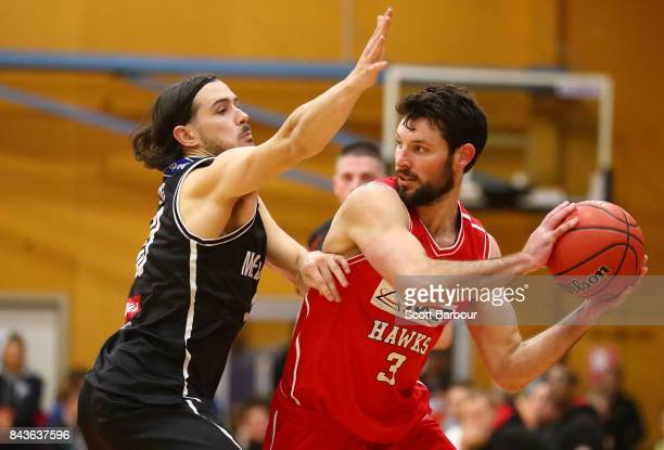 Chris Goulding of Melbourne United and Kevin White of the Hawks compete for the ball during the 2017 NBL Blitz preseason match between Melbourne...