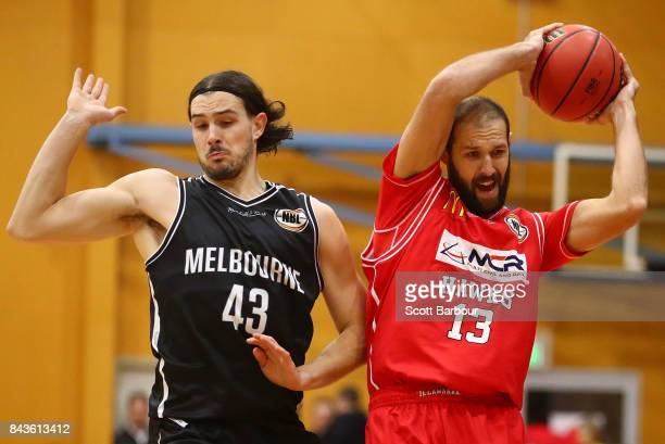 Chris Goulding of Melbourne United and Rhys Martin of the Hawks compete for the ball during the 2017 NBL Blitz preseason match between Melbourne...