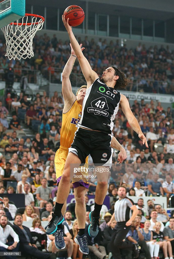 Chris Goulding of Melbourne United drives to the basket as Rhys Carter of the Sydney Kings defends during the round 11 NBL match between Melbourne...