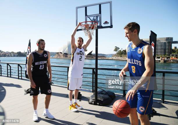 Chris Goulding of Melbourne United Joe Ingles of the Utah Jazz and Daniel Kickert of the Bisbane Bullets shoot baskets during an NBL Media...