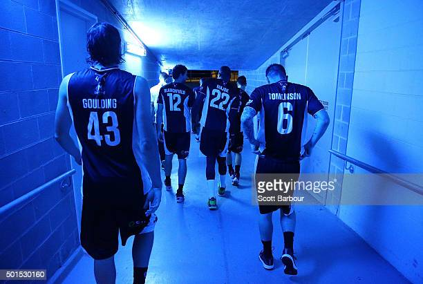Chris Goulding of Melbourne United Nate Tomlinson of Melbourne United and their teammates leave their changing room to enter the arena during the...