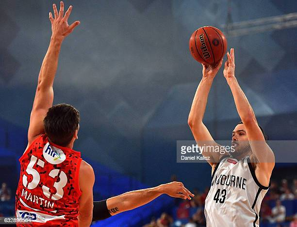 Chris Goulding of Melbourne United shoots as Damian Martin of the Perth Wildcats tries to block during the round 17 NBL match between the Perth...