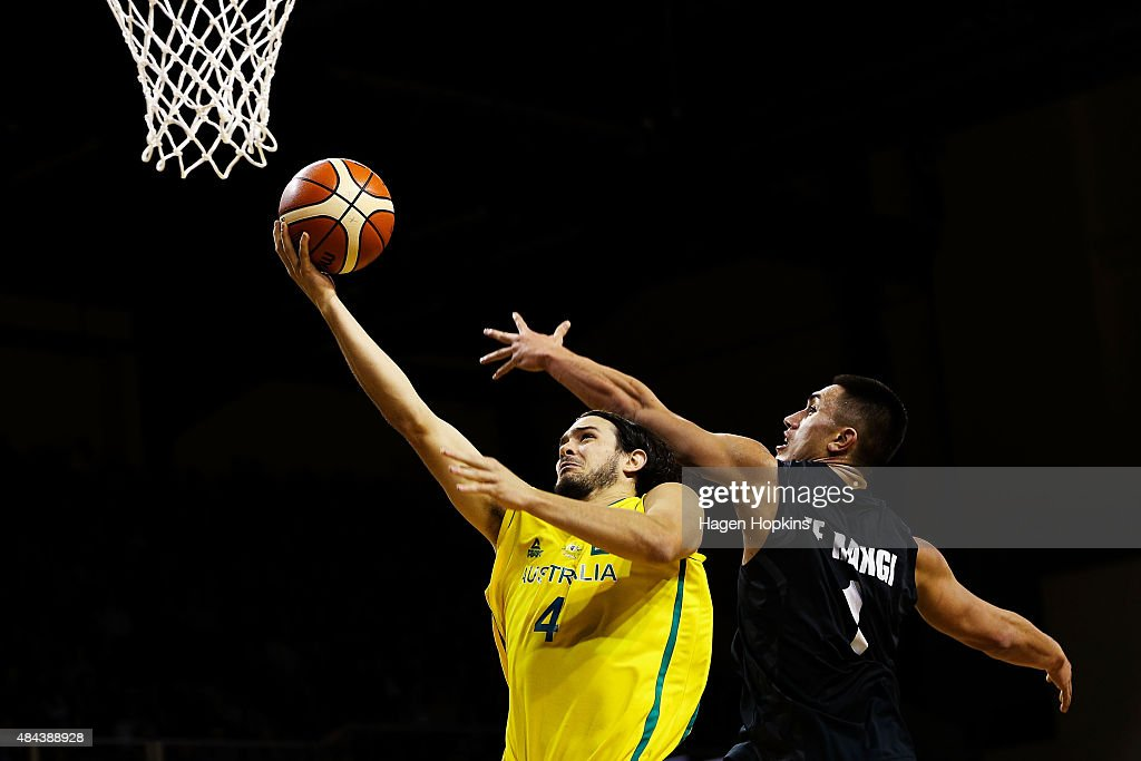 Chris Goulding of the Boomers lays up under pressure from Reuben Te Rangi of the Tall Blacks during the game two match between the New Zealand Tall Blacks and Australian Boomers at at TSB Bank Arena on August 18, 2015 in Wellington, New Zealand.