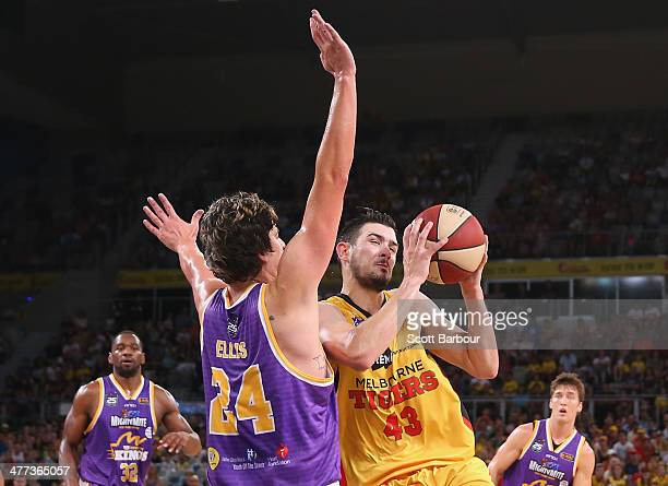 Chris Goulding of the Tigers drives to the basket as Cody Ellis of the Kings defends during the round 21 NBL match between the Melbourne Tigers and...