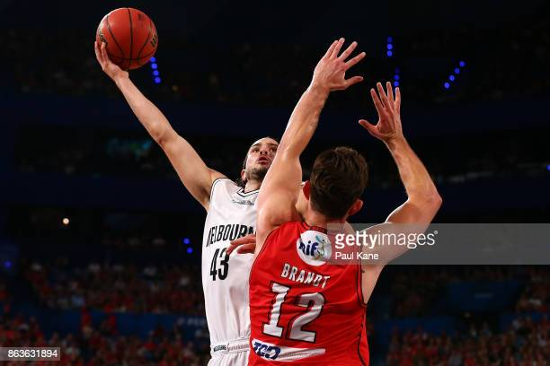 Chris Goulding of United puts a shot up against Angus Brandt of the Wildcats during the round three NBL match between the Perth Wildcats and...