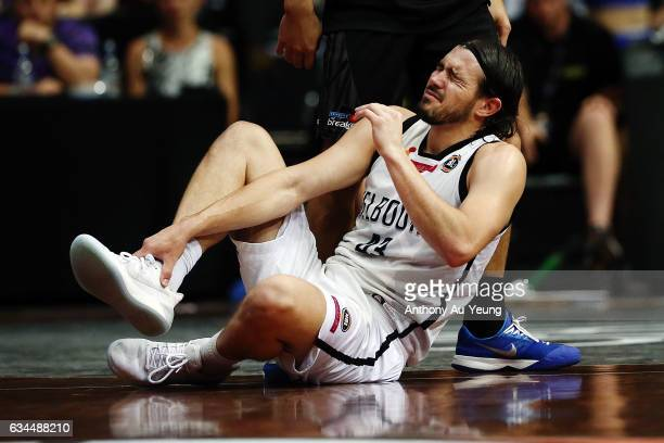 Chris Goulding of United reacts after a slip on the floor during the round 19 NBL match between the New Zealand Breakers and Melbourne United at...