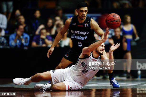 Chris Goulding of United slips on the floor while making a pass as Shea Ili of the Breakers looks on during the round 19 NBL match between the New...