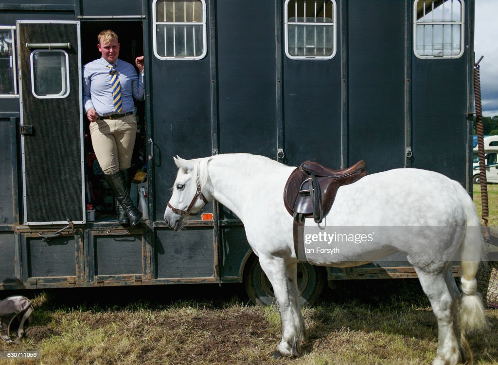 Chris Grant from Heddon on the Wall takes a break at his horsebox after competing during the 194th Sedgefield Show on August 12, 2017 in Sedgefield, England. The annual show is held on the second Saturday each August and is a celebration of agricultural and country life. It offers a range of competitive classes which represent the many skills and aspects of life in the local community, and the countryside including animal classes, vintage machinery and handicrafts.